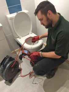 unblocking toilet drain